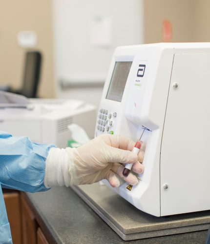 lab tech tests specimen (In-House Laboratory)